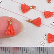 10mm Tiny Tassels - Orange Red