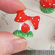 Tiny Group of Red Resin Mushrooms