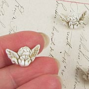 Small Ivory Cherub Buttons